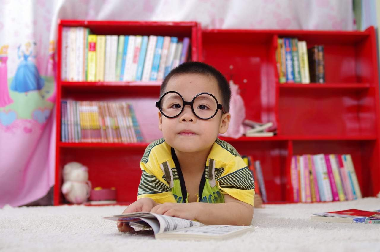 small child with big round glasses